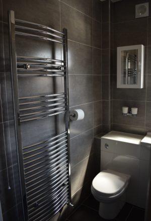 Heated towel rail radiator